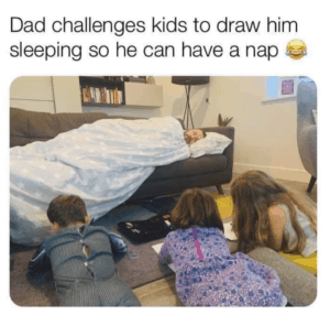 image of dad taking a nap while kids are drawing him