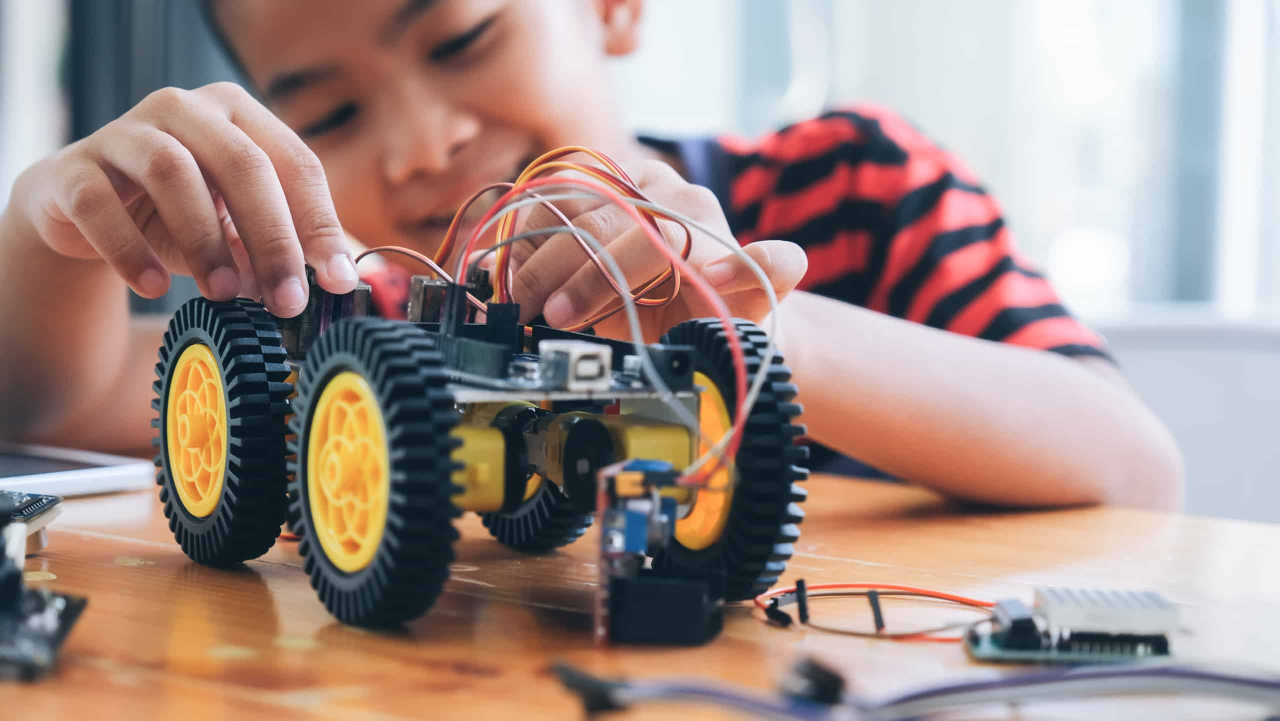 boy building robot