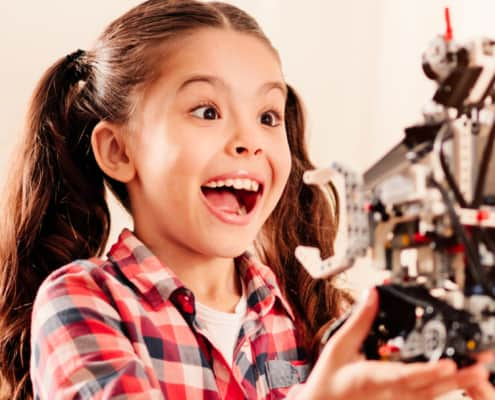 girl excited about robot